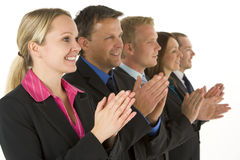 Group Of Business People In A Line Applauding. Group Of Business People In A Line Smiling And Applauding stock images