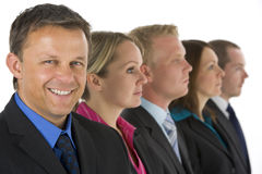 Group Of Business People In A Line Smiling Stock Photos