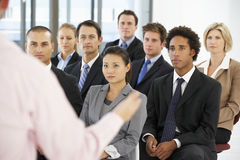 Group Of Business People Listening To Speaker Giving Presentation royalty free stock images
