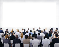Group Of Business People Looking At The Board Royalty Free Stock Image