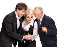 Group of business people looking at a cell phone Royalty Free Stock Photography