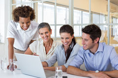 Group of business people looking at laptop Stock Images