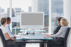 Group of business people looking at a screen Royalty Free Stock Image