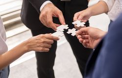 Group of business people making jigsaw and merging,Connecting together royalty free stock photography