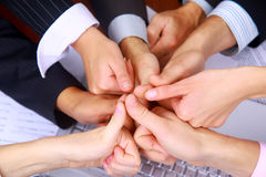 Group of business people making a pile of hands Royalty Free Stock Photos