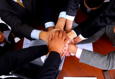 Group of business people making a pile of hands royalty free stock image