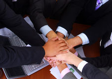 Group of business people making a pile of hands Royalty Free Stock Photo