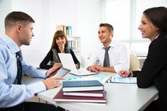 Group of business people. At a meeting around a table in a modern office Royalty Free Stock Photo