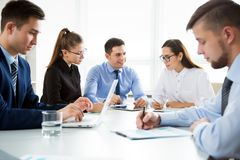 Group of business people. At a meeting around a table in a modern office Stock Photography