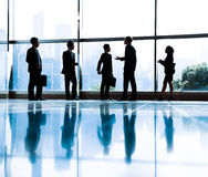 Group of Business People Meeting in Back Lit.  Royalty Free Stock Photography