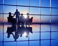 Group of Business People Meeting in Back Lit Royalty Free Stock Photo