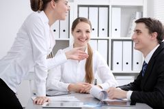 Group of business people at meeting on the background of office. Focus at a beautiful brunette woman royalty free stock photo