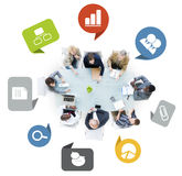 Group of Business People in a Meeting with Business Icons Royalty Free Stock Photo