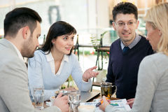 Group of business people  meeting in coffee shop and holding a b Royalty Free Stock Photos