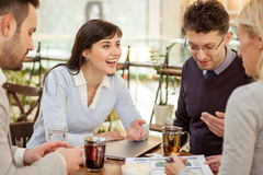 Group of business people  meeting in coffee shop and holding a b Royalty Free Stock Photo