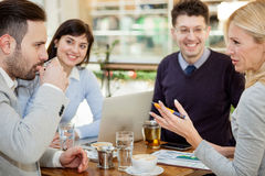 Group of business people  meeting in coffee shop and holding a b Stock Images