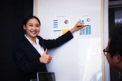 Group of business people meeting about economists working analyzing investment charts. Teamwork successful Meeting Workplace. Group of business people meeting royalty free stock photo