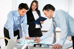 Group of business people at a meeting a. Round a table in a modern office Stock Photo