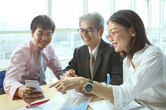 Group of business people meeting with happiness emtion pointing Stock Images