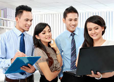 Group of business people meeting with laptop. Group of happy business people working on laptop during meeting Royalty Free Stock Image
