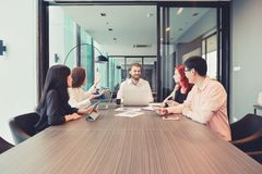 Group of business people meeting in a meeting room, sharing their ideas, Multi ethnic royalty free stock images