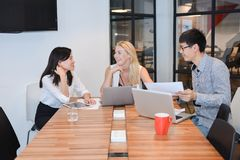 Group of business people meeting in a meeting room, sharing thei. R ideas, Multi ethnics Stock Photo