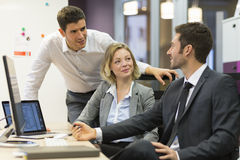 Group of business people in a meeting at office, working on comp Stock Image