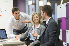 Group of business people in a meeting at office, working on comp Royalty Free Stock Photos