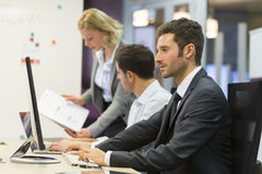 Group of business people in a meeting at office, working on comp Royalty Free Stock Image