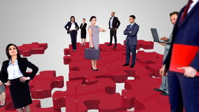Group of business people meeting. On red puzzle stock video footage