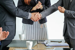 Group of business people meeting shaking hands together Royalty Free Stock Images