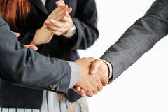 Group of business people meeting shaking hands Stock Photos
