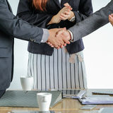 Group of business people meeting shaking hands together Stock Photos