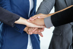 Group of business people meeting shaking hands together Stock Photography