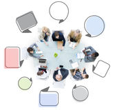 Group of Business People Meeting with Speech Bubbles Stock Images