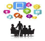 Group of Business People Meeting with Technology Symbol Royalty Free Stock Images