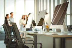 Group of business people meeting together in the modern office.there are many computers on the table. Group of business people meeting together in modern office royalty free stock photography