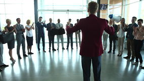 Group of business people of mixed ages are listening to a presentation at a business seminar and clapping. stock footage