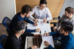 Group of business people in the modern conference room discuss work results. stock photography