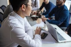 Group of business people in the modern conference room discuss work results. royalty free stock photos