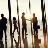 Group of Business People in Office Building Concept Stock Images