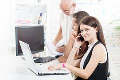 Group business people in office,. Women with laptop royalty free stock image