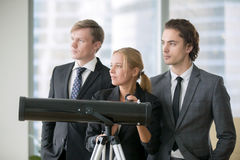 Group of business people with optic telescope royalty free stock photography