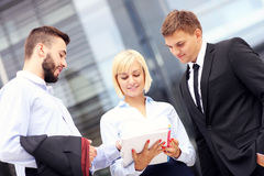 Group of business people outside modern building Royalty Free Stock Image