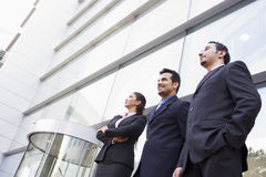 Group of business people outside office. Group of business people outside modern office Stock Photo