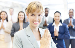 Group of business people paying respect.  Royalty Free Stock Images
