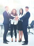 Group of business people piling up their hands together in the w Royalty Free Stock Photos
