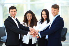 Group of business people piling up their hands Royalty Free Stock Images