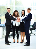 Group of business people piling up their hands Stock Images