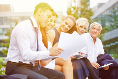 Group of business people planning in summer Stock Photo